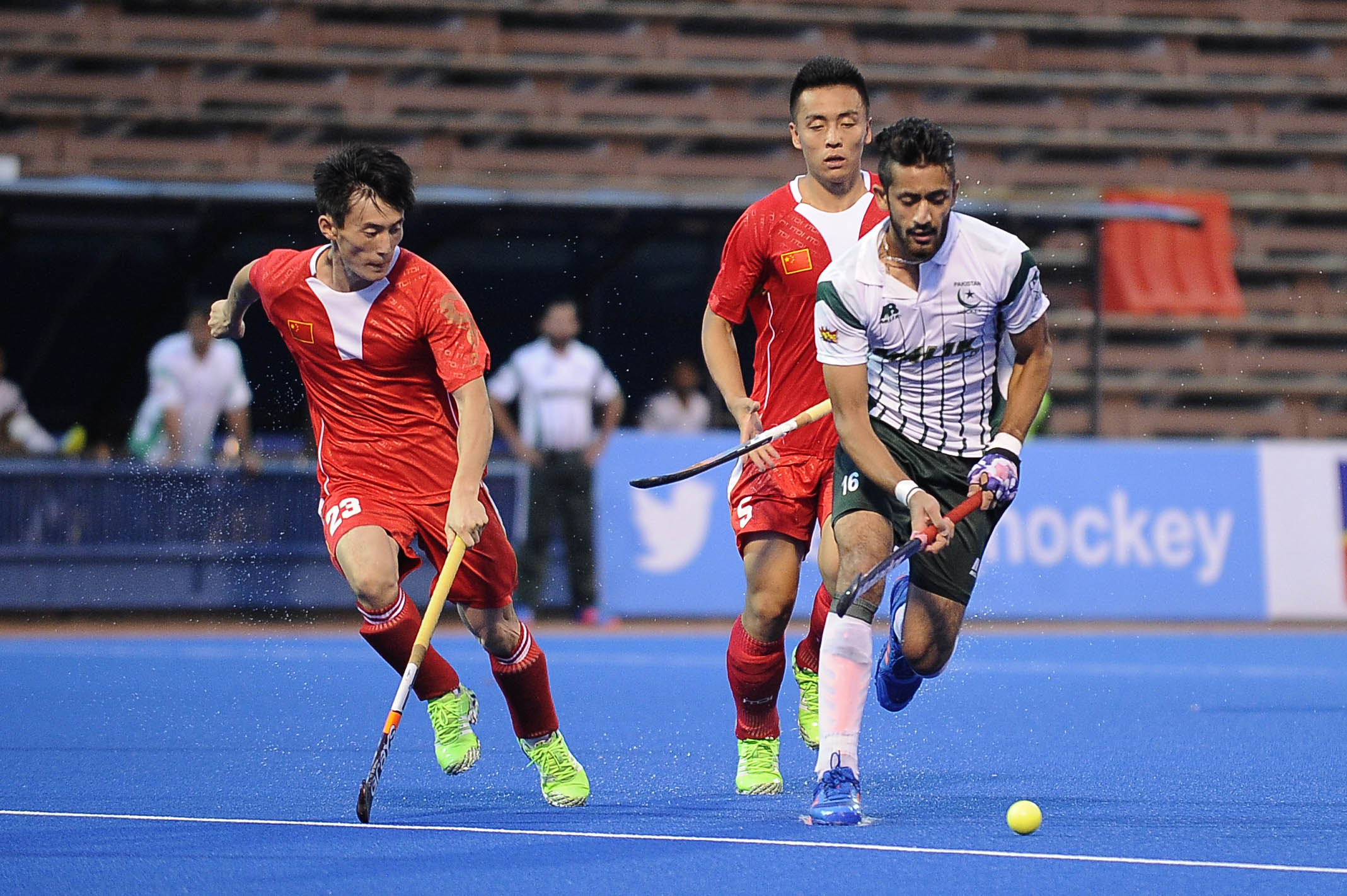 Pakistan's Ammad Shakeel Butt (left) dribbles the ball away from two Chinese players during their QNET 4th Men's Asian Champions Trophy 2016 match at the Wisma Belia Hockey Stadium, Kuantan today. Pakistan won 4-0.