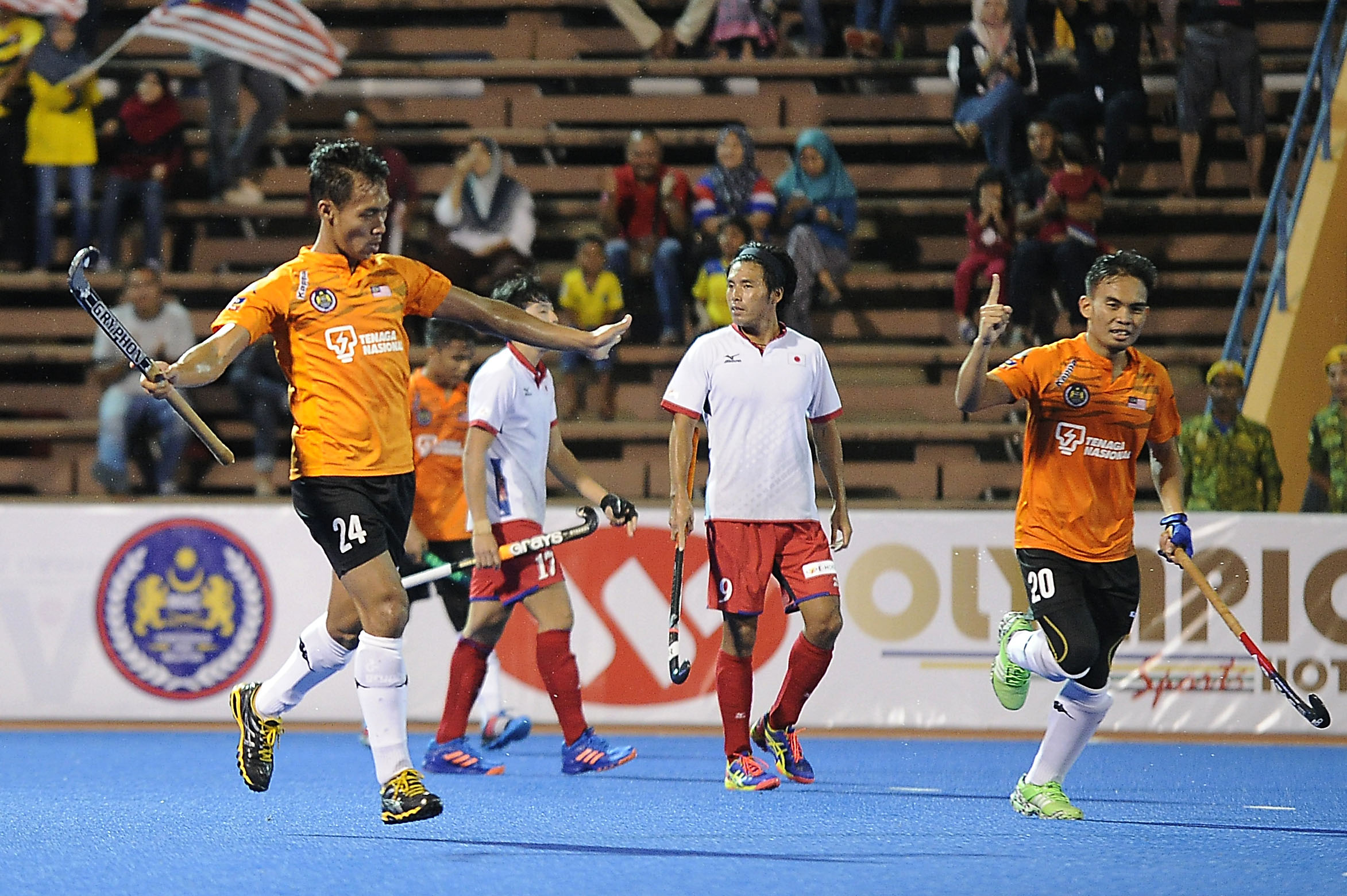 Malaysia's Aiman Nik Rosemi (left) celebrates after scoring against Japan during their QNET 4th Men's Asian Champions Trophy 2016 match at the Wisma Belia Hockey Stadium, Kuantan today. Malaysia won 7-2.